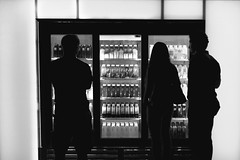 Waiting... Silouettes B&W (vyktureous) Tags: nyc newyorkcity people bw white newyork black silhouette high juice top manhattan silhouettes fake machine illuminated line josh buy and while which vending waits kline on decide waitingman