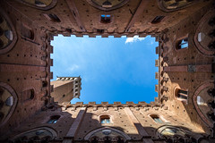 Head Up (MaxSkyMax) Tags: blue windows summer sky italy tower up del canon italia torre estate cloudy blu arc arches fair cielo tuscany campo siena walls mura piazza toscana mangia partly archi finestre