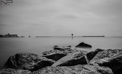 Smooth Sea & Rocks (aquanandy) Tags: longexposure sea beach water blackwhite rocks filter dover calmness weldingglass nikond7000
