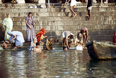 22-925 (ndpa / s. lundeen, archivist) Tags: people india color men film swimming swim 35mm river 22 boat women indian nick steps wash varanasi bathe watersedge bathing 1970s riverbank kashi washing allrightsreserved ganga ganges ghats banaras benares ghat dewolf riversedge uttarpradesh northernindia nickdewolf photographbynickdewolf reel22 thenickdewolffoundation imageuserequestsarewelcomeviaflickrmailornickdewolfphotoarchiveatgmaildotcom