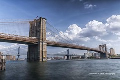 Two Bridges (ImagesByRayD) Tags: nyc newyorkcity longexposure summer water brooklyn clouds landscape downtown waterfront manhattan logs brooklynbridge manhattanbridge eastriver fdrdrive waterway 2470mm ndfilter canon5dmarkiii raymondkdash raymondkdashphotography rkdashphotosgmailcom