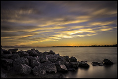 Petrie Sunset (Uncle_Greg) Tags: sunset sky orange ontario water clouds river island orleans rocks long exposure ottawa petrie