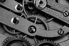 Inside a pocket watch (Explore) (Cajofavi) Tags: macromondays bw watch pocketwatch cogwheel gearwheel macro
