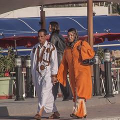 colourful couple (Jan Herremans) Tags: africa morocco agadir janherremans candid colour traditionnal clothing djellabah jihab orange