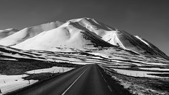 Let's drive right into winter (lunaryuna) Tags: iceland road roadtrip landscape mountains snow ice light weather weathermood spring season seasonalwonders travel journey lunaryuna blackwhite bw monochrome snowcappedmountain ngc