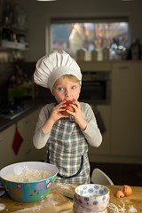 Little chef eating an apple