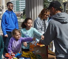 These two young girls from a local church group help serve a free lunch at Civic Center park in Denver. (desrowVISUALS.com) Tags: kids economics economy children poverty poorpeople austerity economiccrisis poor service compassion love luncheschurch setfreechurch freelunch