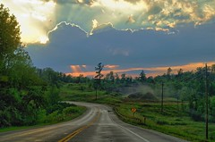 North Country Storm Clouds (FlappinMothra) Tags: road woman cloud sun sunlight lake storm minnesota long pentax north northern mn minn hdr hackensack k30 easyhdr