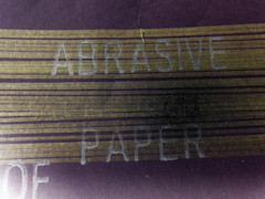 SAND PAPER (Drew Daves) Tags: lines paper found back purple text flash experiment minimal marker rough invert sandpaper