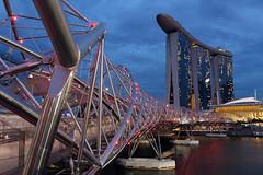 Marina Bay Sands (Singapore) (rogelio g arcangel) Tags: lighting city longexposure nightphotography travel sunset sky urban architecture clouds canon reflections lights twilight singapore asia cityscape skyscrapers sundown nightscenes marinabay marinabaysands