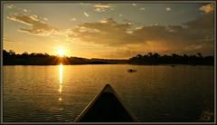 Bathed in beauty (WanaM3) Tags: park sun reflection nature water clouds sunrise golden texas sony canoe bayou bow sunburst pasadena canoeing paddling bayareapark clearlakecity a700 armandbayou sonya700 wanam3