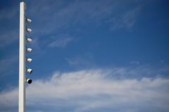 Gradual (24thcentury) Tags: blue sky white tower clouds lights oakland pillar baybridge eastspan
