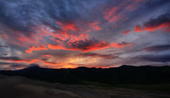 Dune Fire (Waterfall Guy) Tags: park sky mountains clouds sunrise dawn sand colorado dunes great national