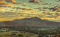 Sunrise Over Squaw Butte (http://fineartamerica.com/profiles/robert-bales.ht) Tags: morning trees mountain beautiful yellow clouds sunrise wow landscape town photo spring flickr butte superb sweet farm awesome fineart scenic surreal peaceful panoramic idaho boise sensational inspirational spiritual tranquil emmett magnificent rollinghills inspiring haybales facebook stupendous tw