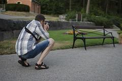 Photographing a photographer? (Lisa Josefsson) Tags: trees church graveyard pine last garden evening woods norrkping gravel