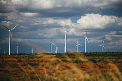 Roscoe, TX (BurlapZack) Tags: vacation cloud field grass clouds bokeh anniversary farm roadtrip telephoto blueskies agriculture turbine futuristic tallgrass turbines weekendgetaway canonef24105mmf4lisusm cleanenergy sweetwatertx renewableresources canoneos5dmarkii roscoetx sweetwaterwindfarm