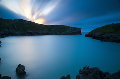 Playa de Nueva (dni09) Tags: sunset espaa mar spain asturias playa puestadesol llanes largaexposicion