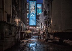 Small girl, big city (urbanexpl0rer) Tags: toronto ontario canada alley night nightphotography streetphotography truck billboards 1person reflections x1d