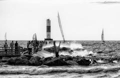 No Swimming! (leapinlily) Tags: lakemichigan sailboats beach pier splash blackandwhite lighthouse