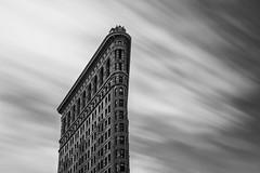 Flatiron Building ([~Bryan~]) Tags: flatironbuilding flatiron architecture nyc newyork manhattan bw monochrome daytimelongexposure longexposure us city urbanlandscape