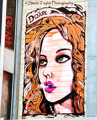 Smokin' (Steve Taylor (Photography)) Tags: street city pink newzealand christchurch portrait orange woman streetart art st lady hair graffiti ginger mural heart head smoke pearls greeneyes southisland cbd rise breathe ymca hereford drapl
