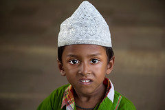 Portrait of a boy in Galachipa, Bangladesh. (cookiesound) Tags: travel boy portrait face canon children photography asia child muslim islam bangladesh reise travelphotography reisefotografie muslimboy galachipa cookiesound eypression nisamaier ullimaier