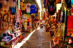 Jerusalem_Old City market_6_Noam Chen_ IMOT (Israel_photo_gallery) Tags: people shopping israel commerce market jerusalem markets goods clothes fabric leisure recreation bags jewelery marketstreet economy oldcity fabrics kippot religiousarticles noamchen