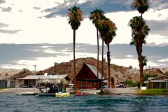 Pirates Cove (See El Photo) Tags: blue summer sky mountain color building tree wet water bar river boats colorful coloradoriver boating gre
