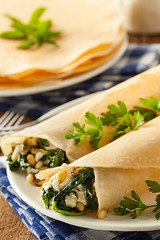 Delicious Homemade Spinach and Feta Savory French Crepes (brent.hofacker) Tags: food hot cake pancakes breakfast french dessert gold golden stuffed healthy european sweet traditional tasty fresh sugar gourmet delicious filled homemade snack crepe pastry folded pancake thin crepes savory spinach feta baked rolled flapjack frenchcrepes