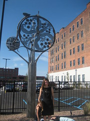 New Spirit of Transportation: Original Sculpture by Sarah Fonzi, Buffalo NY (ianulimac) Tags: new city flowers summer urban sculpture ny tree green history bicycle metal hub buffalo artwork stainlesssteel artist apartments lakeerie bricks victorian august transportation future infrastructure artdeco local unveiling commission lofts talented rehab grandopening manufacture thefoundry 2014 welder craftspeople resurgence sarahfonzi 149swanstreetbuffalony14203 newspiritoftransportation