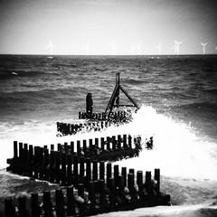 Dark Waves (AMcUK) Tags: bw beach vintage square holga norfolk grain retro caister caisterbeach olympusartfilter olympusgrainyfilm holgamicro43rds