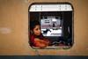Out of town traveller (Lil [Kristen Elsby]) Tags: travel portrait train topf50 asia trainstation editorial dhaka topv3333 topv4444 bangladesh kamlapur southasia bangladeshi traincarriage travelphotography kamalapur canon5dmarkii kamalapurtrainstation