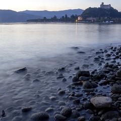 La riva nascosta (_milo_) Tags: italy lake canon lago eos italia riva sassi castello rocca lagomaggiore manfrotto sera mosso oasi angera borromeo 18135 ciottoli treppiede 60d bruschera