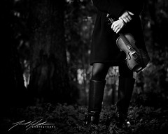 The Violin (jaredhughesphoto) Tags: violin music hands lady girl pretty serene serenity woods leaves leaf blackwhite bnwfineart instrument viola child children artist boots branches autumn winter seasonal portrait branch coat pea peacoat young woman
