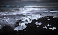 The ice of a thousand years (Sebastian Feuerherm) Tags: landscape rocks beach pebbles ice iceland longtimeexposure water blue black white sky sea clouds ocean rain river overcast badweather storm sand dark lagoon gray glacier nopeople nobody stones foam spray