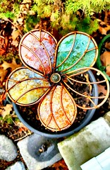 Whimsical Flower (SurFeRGiRL30) Tags: glass flower whimsical glassflower nj garden colorful petals metal copper dirt leaves spring