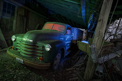 Dutch Angle Farm Truck III (Notley Hawkins) Tags: rural missouri notley notleyhawkins 10thavenue httpwwwnotleyhawkinscom missouriphotography notleyhawkinsphotography lightpainting bluelight greenlight blue green night nocturne 光绘 光繪 lichtmalerei pinturadeluz ライトペインティング प्रकाशपेंटिंग ציוראור اللوحةالضوء abandoned longexposure ruralphotography chartitoncountymissouri red redlight rgb outdoor 2017 riverbottoms missouririverbottoms truck farmtruck chevrolet march rafters roof ceiling