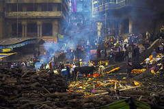 Smoke, Dead and Cows. (Thijs de Zeeuw) Tags: cows dead cremation fire hindu colors varanasi ritual flowers city street