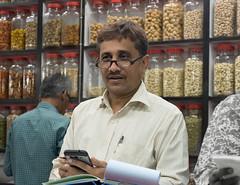 Stall holder, Crawford Market (JohnMawer) Tags: man mumbai portrait shopkeeper crawfordmarket glasses bombay india maharashtra in
