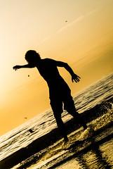 Skimboarding @ Zaandvoort Beach (vnkht) Tags: sunset sunlight black netherlands sunshine silhouette strand lumix evening raw dusk thenetherlands panasonic f71 skimboarding zandvoort 2012 noordholland 120mm lightroom nederlanden skimming northholland skimboarder iso80 zandvoortaanzee zandvoortbeach lx5 dmclx5 lightroom5 gavinkwhite