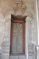 Decorative door at Haw Phra Kaew (oldandsolo) Tags: southeastasia buddhism laos touristspot vientaine buddhistshrine laopdr religiousshrine laoscapital buddhistreligion hawphrakew buddhistfaith formerhomeoftheemeraldbuddha