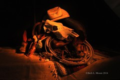 Down at the ranch (moorepix4u2c) Tags: ranch light stilllife lightpainting spurs skull gun texas flash rope pistol western cowboyhat horseshoes saddle holster cowboyboots lasso brandingiron planophotographyclub