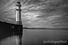 Lightstopper (Ross Forsyth - tigerfastimagery) Tags: sea blackandwhite bw lighthouse mono scotland edinburgh harbour newhaven longshutter stopper firthofforth slowshutterspeed 15seconds newhavenharbour leefilters harbourlighthouse newhavenharbourlighthouse bigstopper leebigstopper