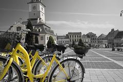 Brasov (Sorin Olteanu) Tags: city travel blackandwhite bicycle yellow cityscape samsung nx nx2000