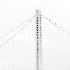 The New Bay Bridge (catlucia) Tags: sanfrancisco bridge blur lensbaby oakland baybridge bayarea suspensionbridge sfist oaklandbaybridge easternspan edge80