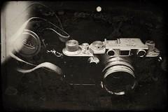 Dad's old Leica-9808 (Poetic Medium) Tags: leica kitcamghostbird possession vintage rip snapseed 35mm camera male stilllife blackandwhite birthday ipod