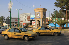 Clock square (Wild Chroma) Tags: kashan iran square traffic taxi roundabout