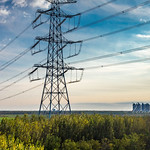 High voltage power supply and distant high-rise apartments along the countryside thumbnail