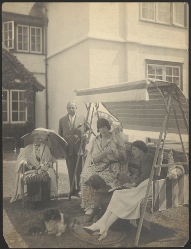 [Portrait of Dame Clara Butt, Mr. and Mrs. Rumford and Constance Collier sitting outdoors with their pets]