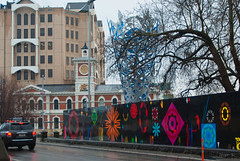 A Splash of Colour for Wet Day (Jocey K) Tags: street trees newzealand christchurch sky sculpture streetart art wet architecture buildings mural clocktower cbd painitng challis earthquakedamage cathedralsq